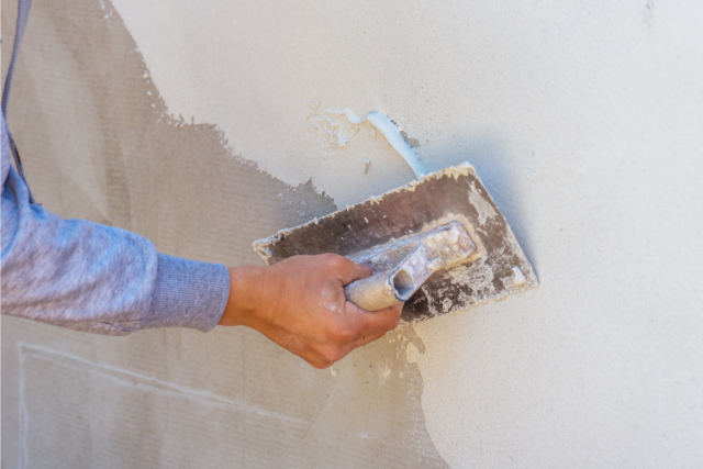 Residential Concrete Wall Repair by worker